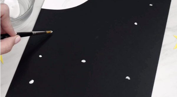 hand painting black background with white specks