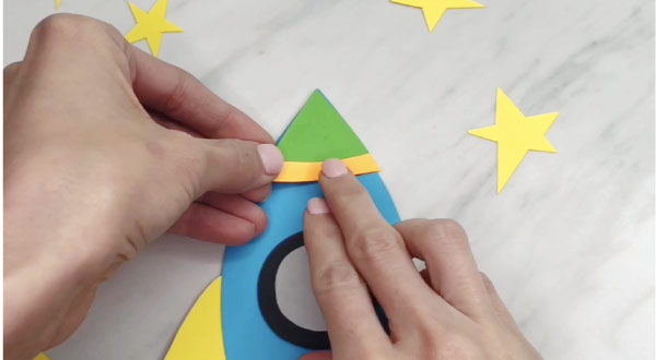hand gluing top of rocket