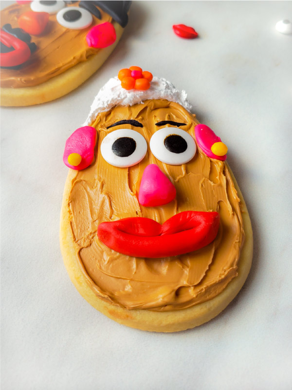 Mr. & Mrs. Potato Head Cookies | Make these DIY sugar cookies for your next Toy Story birthday party or just for fun! They're simple enough to have the kids help too! #themedbirthdays #birthdayparty #parties #partyfood #toystory #toystory4 #disney #partyideas #sugarcookies #cookies #desserts #kidsfood