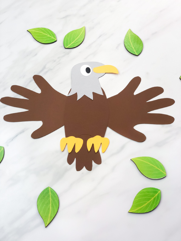 picture of handprint eagle with leaves scattered around it