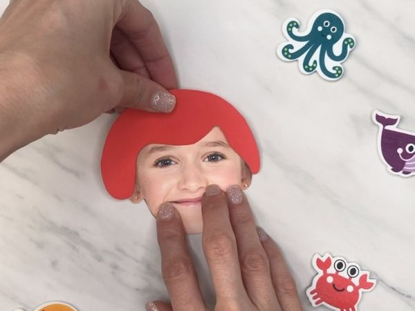 gluing mermaid hair on girl's photo face