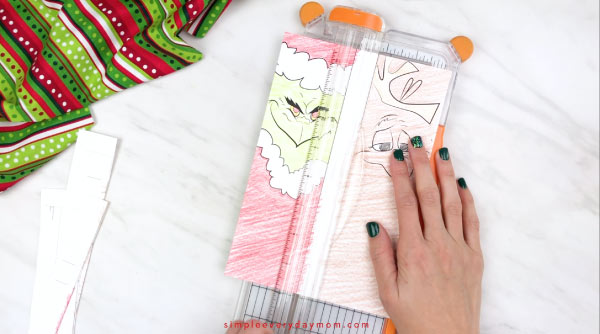 hands trimming printable grinch bookrmarks