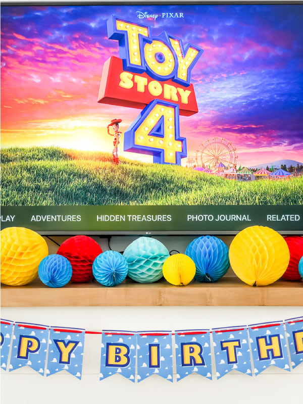 Closeup of Toy Story 4 party decorations on fireplace