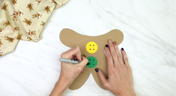 hand drawing button holes on to paper bag gingerbread craft