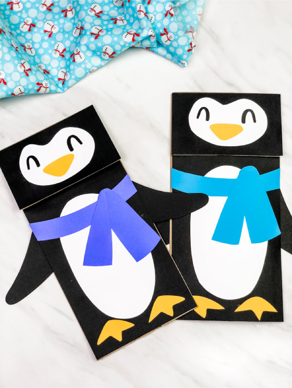 two paper bag penguin crafts