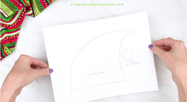 Hands holding elf headband craft template