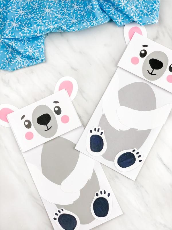 Two polar bear paper bag puppets
