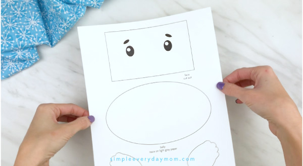 Hands holding paper bag polar bear craft template