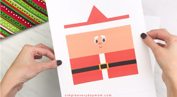 Hands holding toilet paper roll Santa craft template