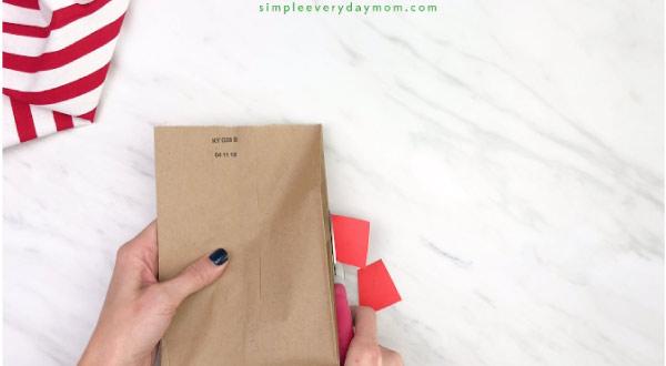 hands trimming paper off paper bag reindeer craft