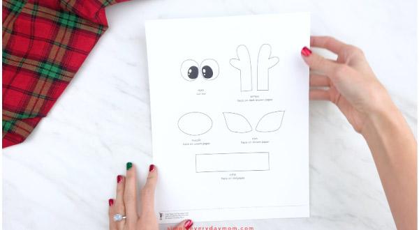 hands holding toilet paper roll reindeer craft template