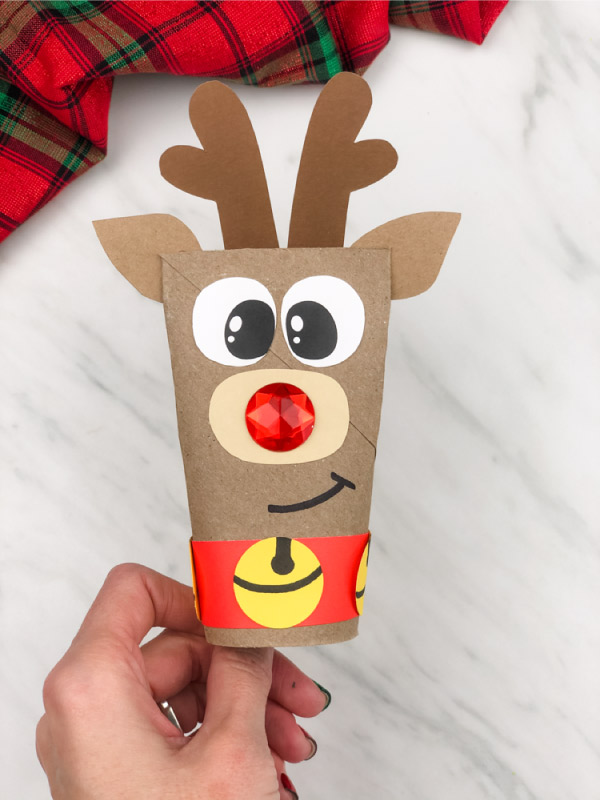 hand holding toilet paper roll reindeer craft