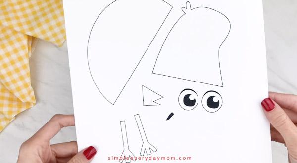 hands holding handprint robin craft template