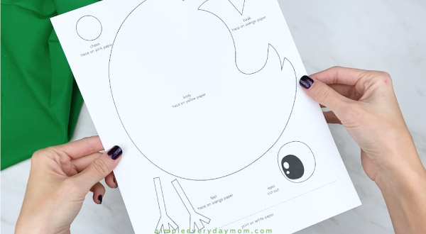 Hands holding handprint chick craft template