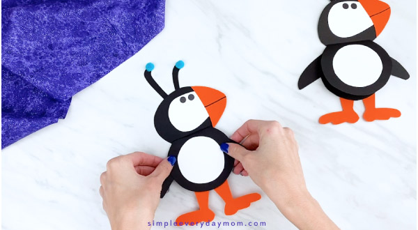 Hands holding puffin card craft