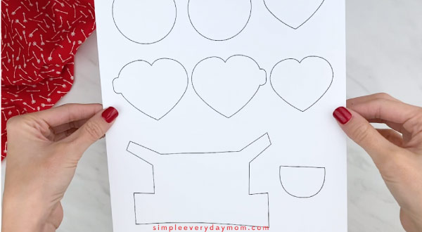 Hands holding valentine minion craft template
