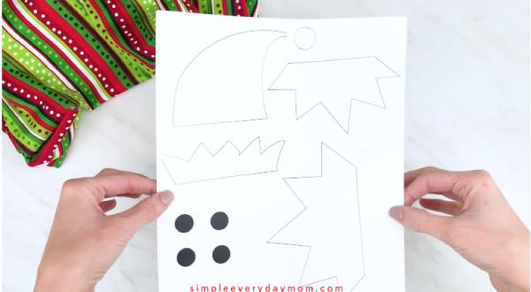 Hands holding handprint elf card craft template