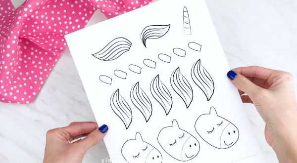 Hands holding unicorn craft template