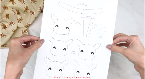 Hands holding handprint reindeer craft template
