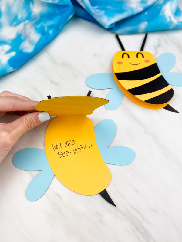 Hand opening paper bee card craft
