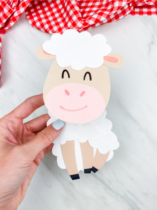 Hand holding paper sheep card craft