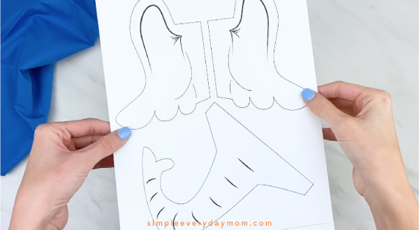 Hands holding Horton paper bag craft template