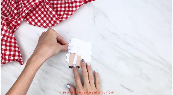 Hands gluing sheep fluff onto sheep card craft