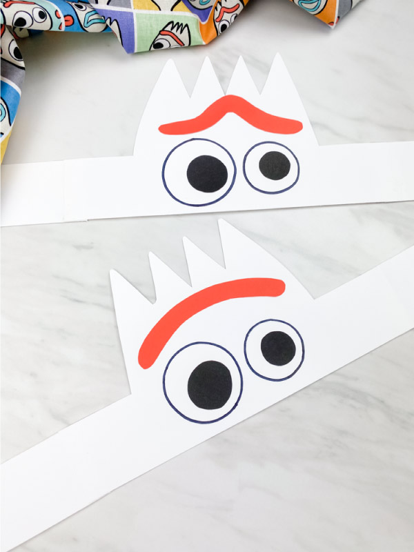 two flat paper Forky headbands