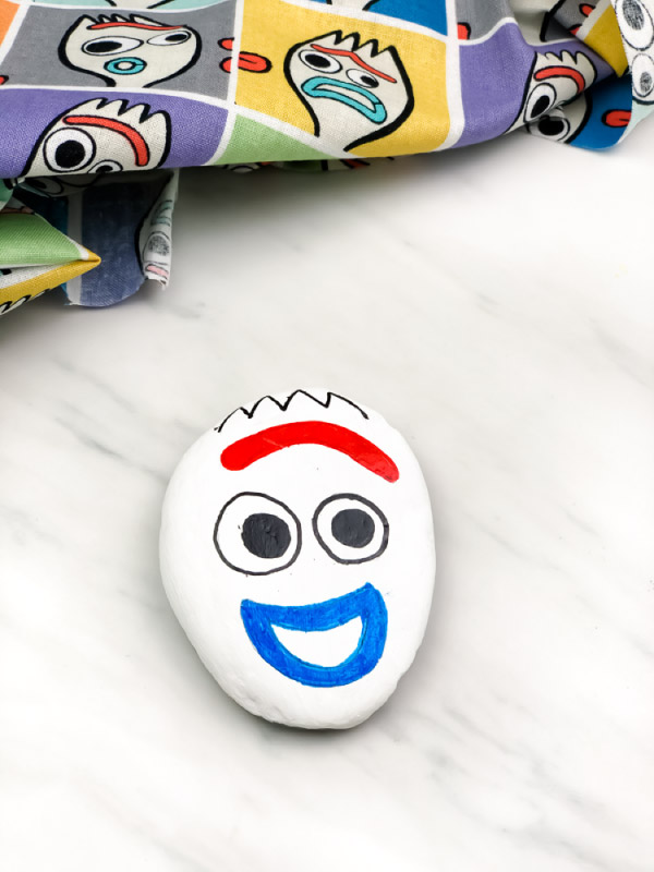forky painted rock smiling