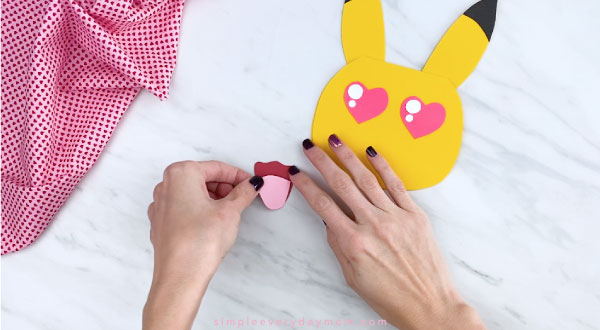 Hands gluing tongue on PIkachu mouth