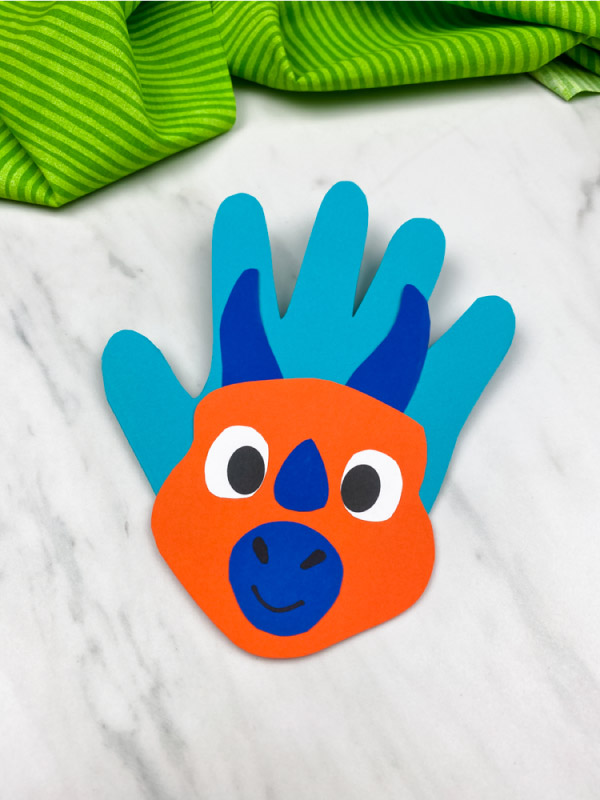 orange and blue handprint dinosaur card