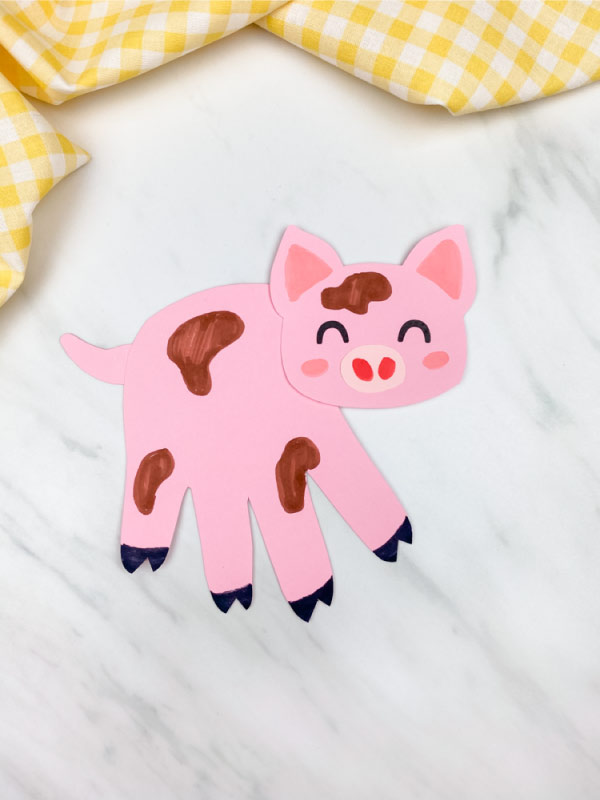 pink handprint pig with muddy spots