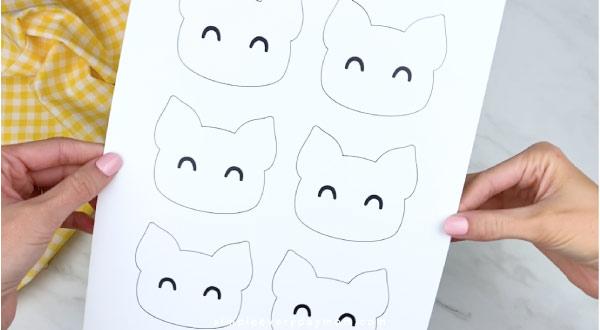 Hands holding handprint pig craft template