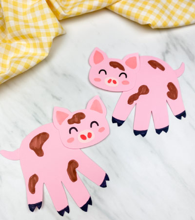 2 handprint pig crafts