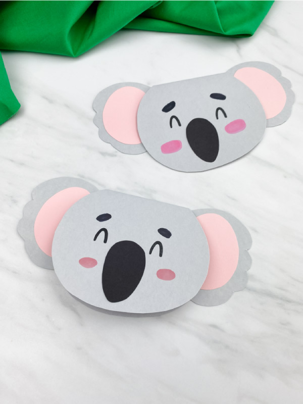 two gray koala cards with green fabric