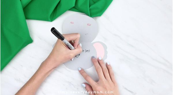 hand writing message inside koala card