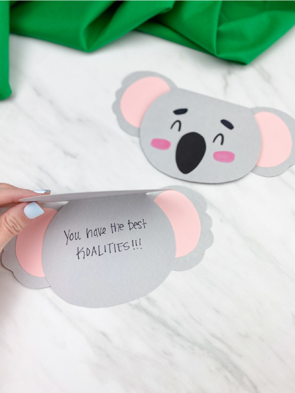 hand opening homemade koala card