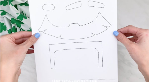 Hands holding paper bag leprechaun craft template