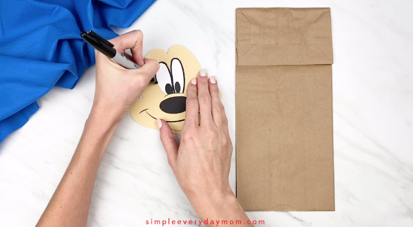 hands outline eyes on mickey mouse paper craft