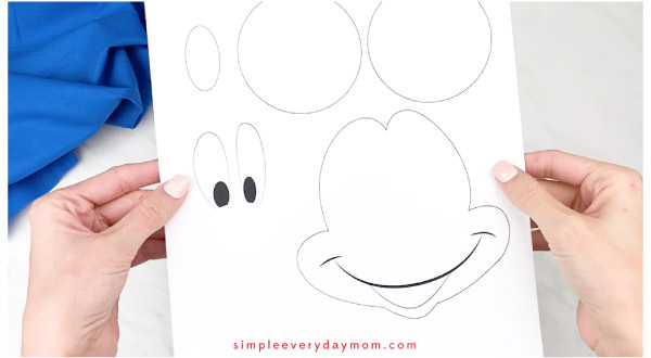 hands holding mickey mouse template