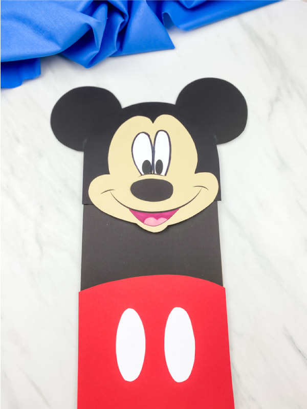 mickey mouse paper bag puppet craft with blue fabric