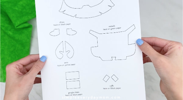 Hands holding leprechaun minion craft template