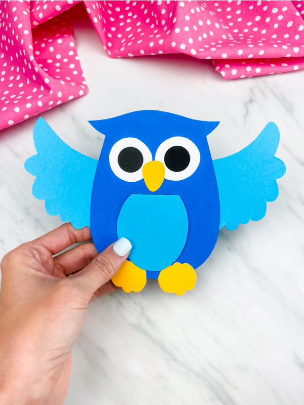 hand holding blue owl paper craft