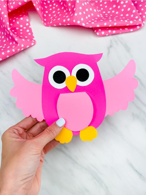 hand holding pink owl craft