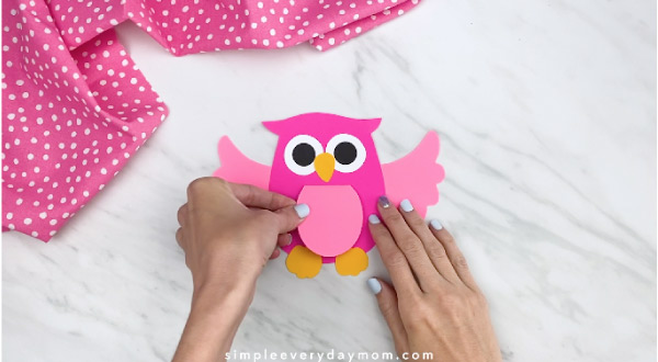 hands gluing belly to owl card craft