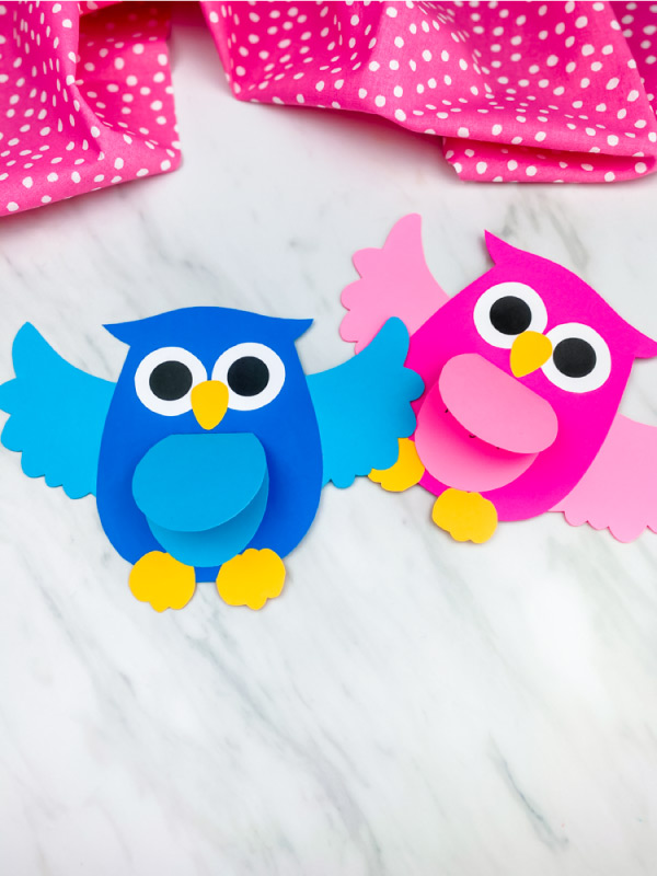 pink and blue owl craft on marble background with pink dot fabric