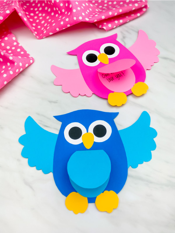 blue and pink owl card craft on marble background