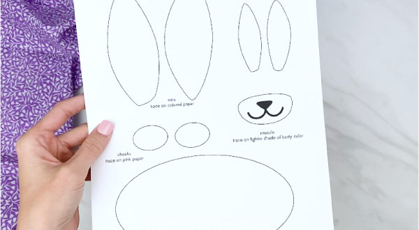 Hands holding paper bag bunny craft template