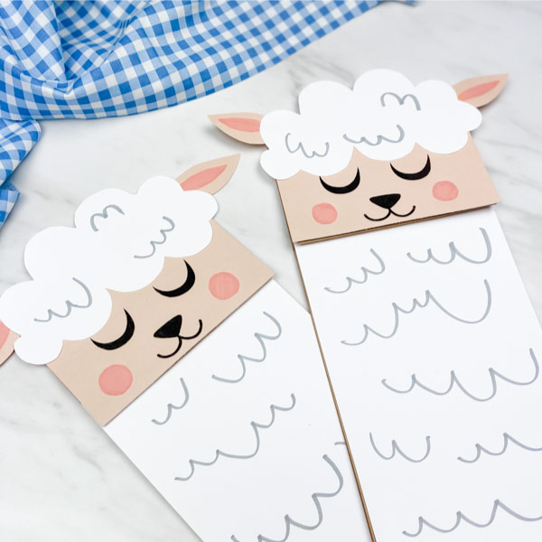 Closeup of two paper bag sheep crafts