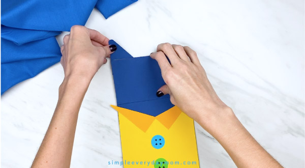 hands gluing paper Pete the Cat ears onto craft